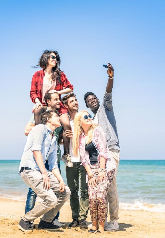 Group taking selfie for social media